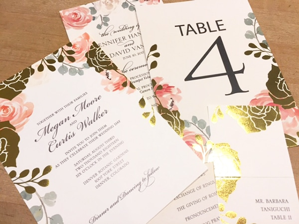 Gold foil and floral wedding invitations, program, table number, place card